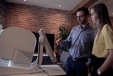 man and women looking at computer screen