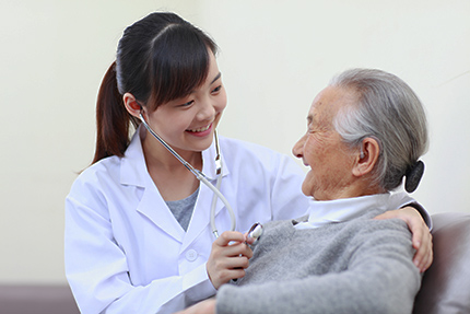 senior woman with doctor