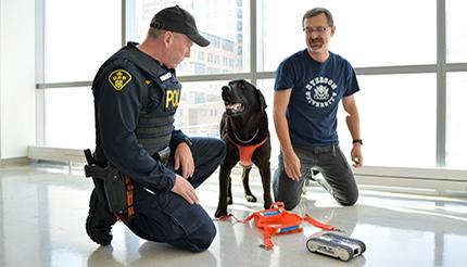 Alex Ferworn and OPP canine officer