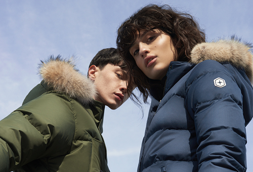 Young man and woman in winter parkas
